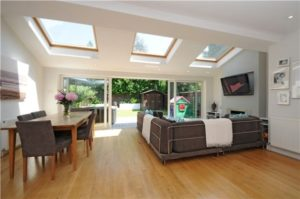 I love the sky lights and the back windows that open to the ... | living room extension