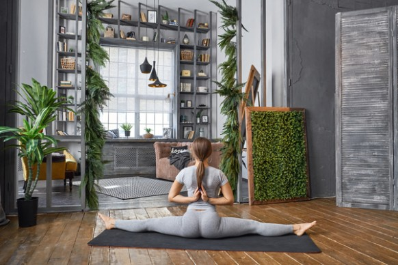Woman practicing yoga in the living room Stock Photo 18 free download - living room yoga | living room yoga