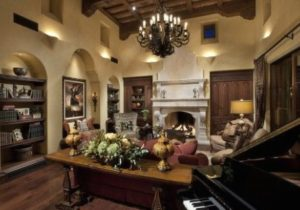 living room tuscan colors. Uplights in nitches. Sofa table display ..